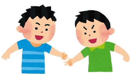 じゃんけんをする男の子2人 右の子は、チョキを出し、左の子はグーを出している。